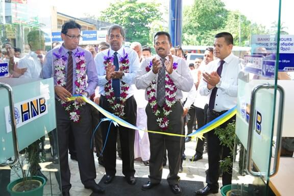 Nirosh Perera, Assistant General Manager - Network Management and other dignitaries from Hatton National Bank, opening the new customer centre at Ampara Sri Lanka