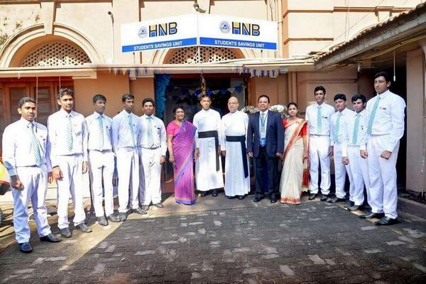 Managing Director/CEO of HNB, Jonathan Alles with Rev. Fr. Travis Gabriel, Rector, St.Joseph's College , Rev. Fr. Anton Ranjith, Vice Rector, St. Joseph's College, Ms. Nimala Perera, Ms. Ronali Nugera, teachers in charge of Students Savings Unit and student managers of the college.